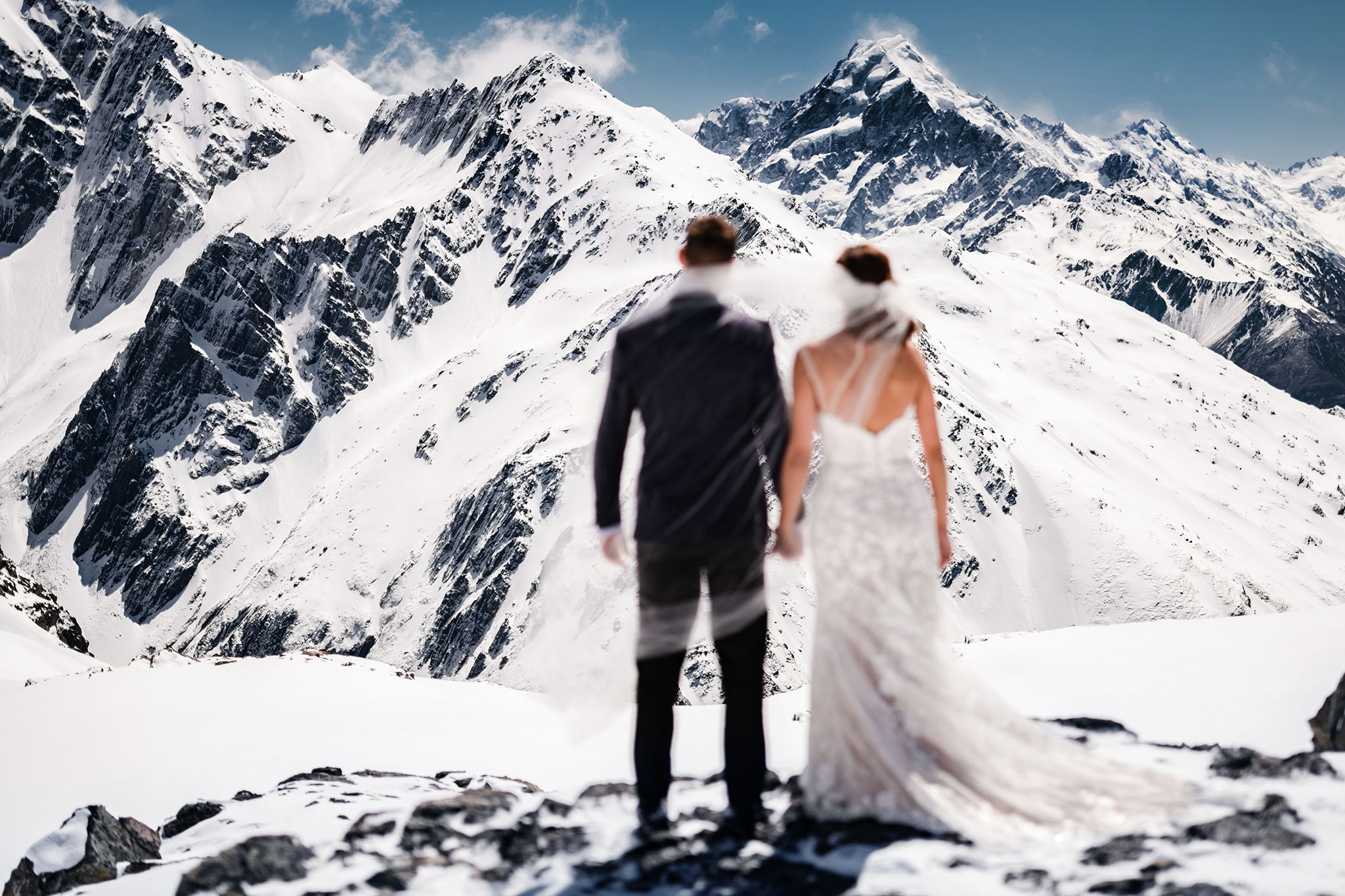 epic mountain wedding couple snow tops