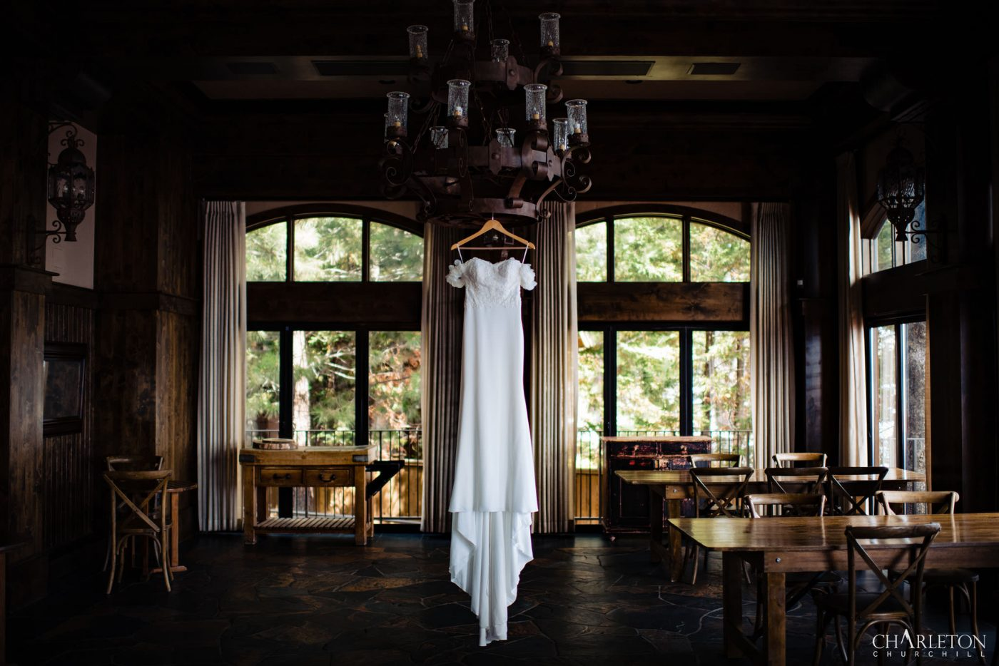feather arm wedding gown hanging from light in west shore inn
