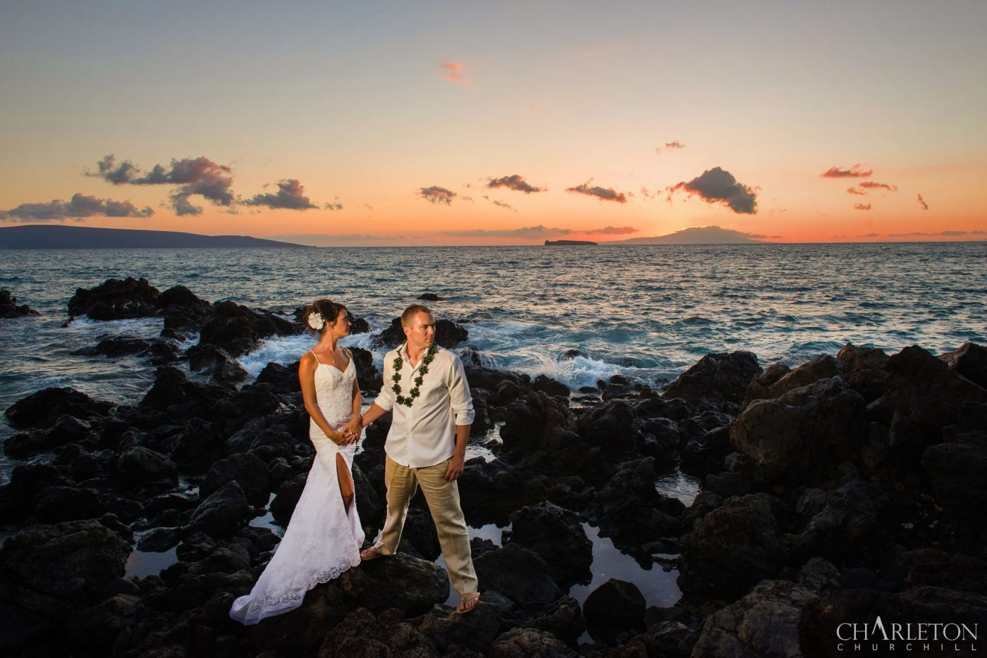 wedding couple on beach in maui, hawaii by elopement photographer during sunset in Wailea beach