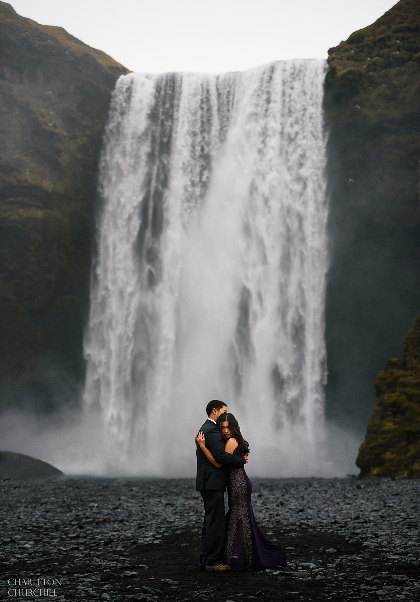 iceland adventure wedding photographer at Skogafoss with eloping couple
