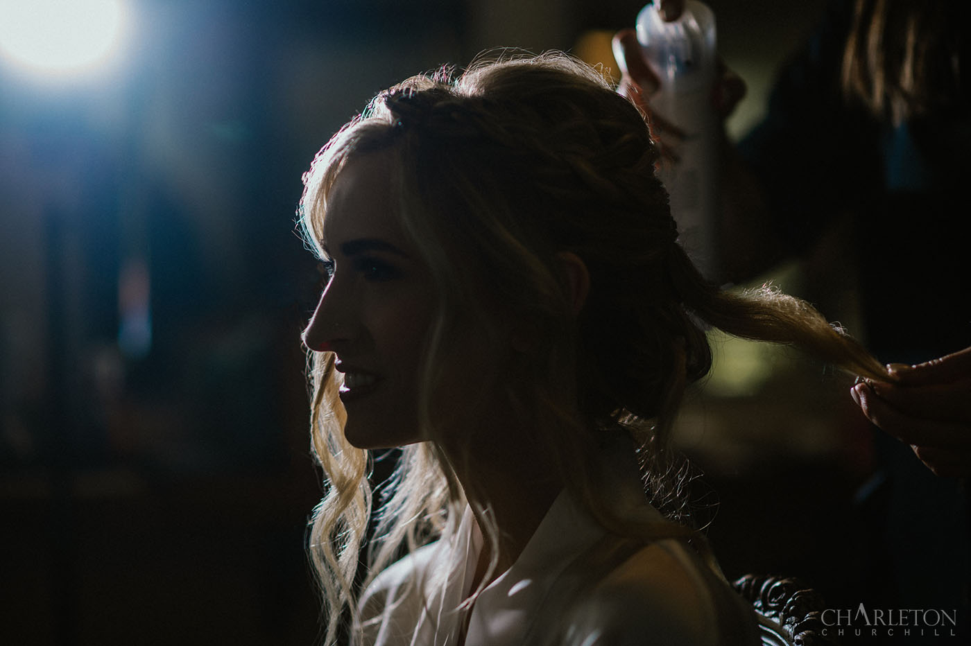 bride with speedlight flash during hair and makeup