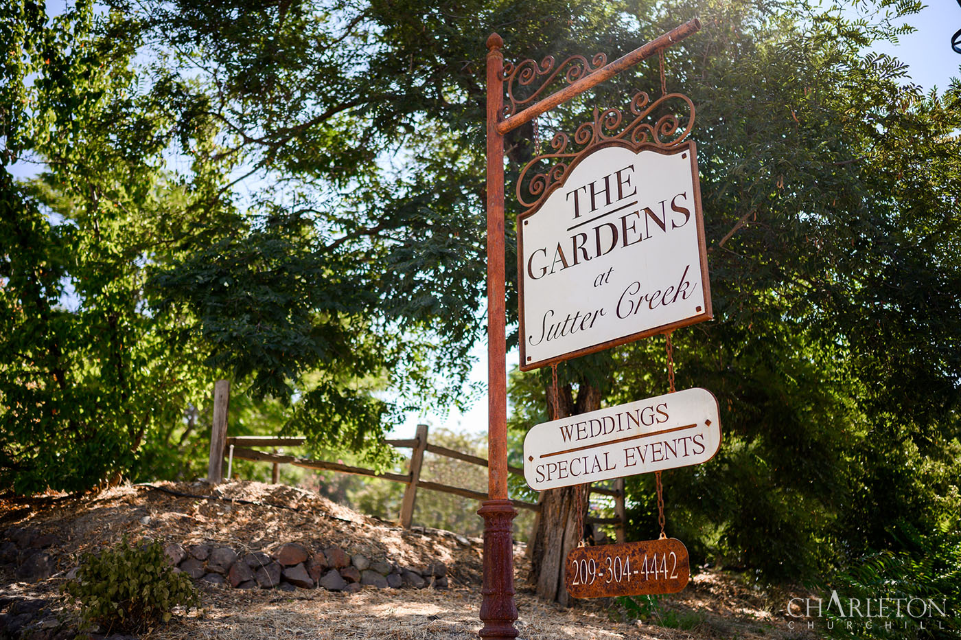 The gardens at sutter creek sign on hwy 49