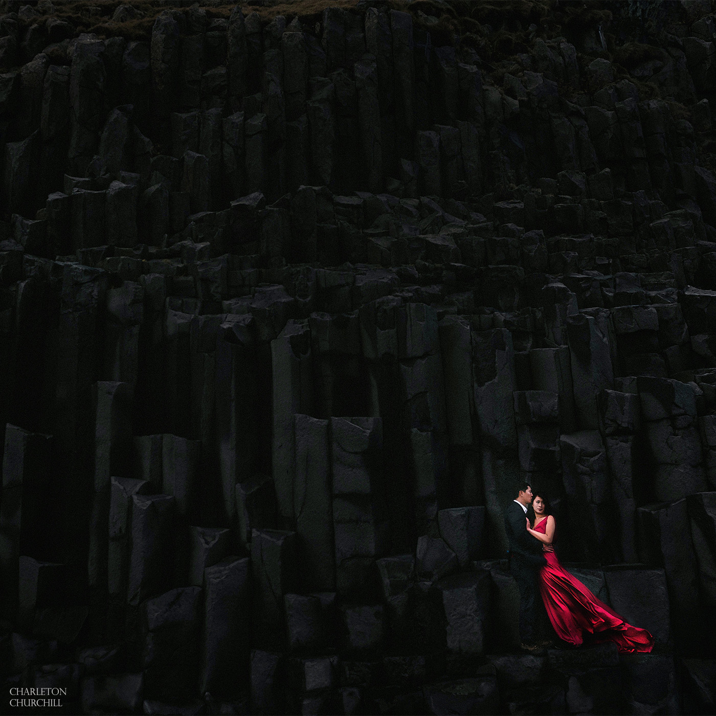 eloping couple in Iceland on an adventure at Reynisfjara Black Sand Beach