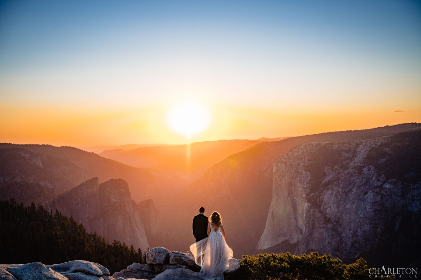 Rush Creek Lodge wedding ceremony in Yosemite national park at sunset at Taft point and Sentinel point