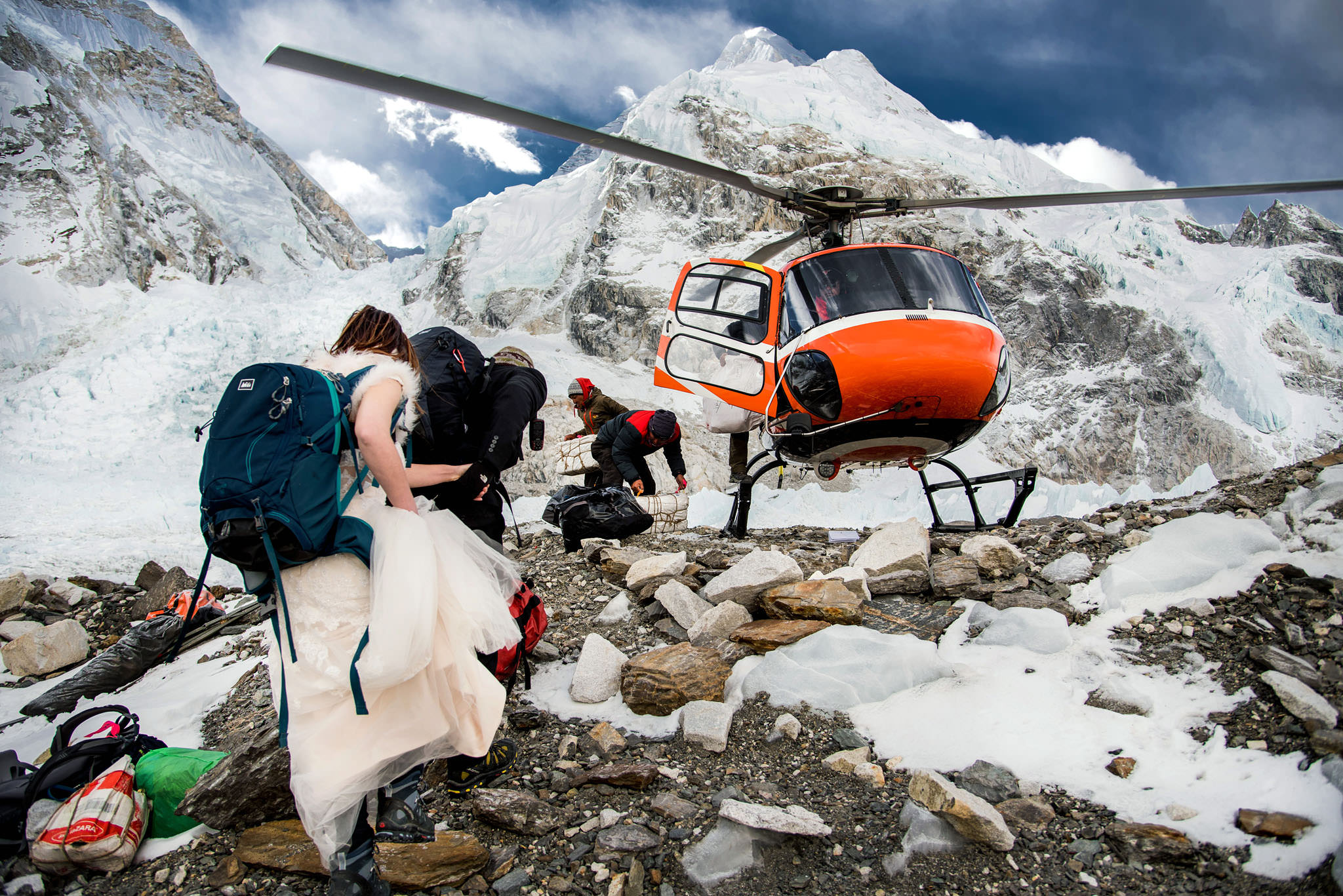 himalayas mt. everest wedding with helicopter escorting couple down the mountain