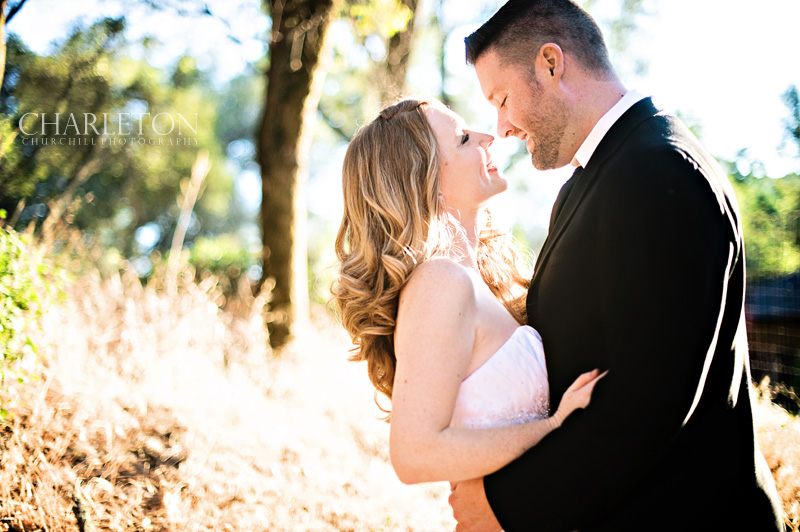 a couple shares a romantic moment in the landscape foiliage