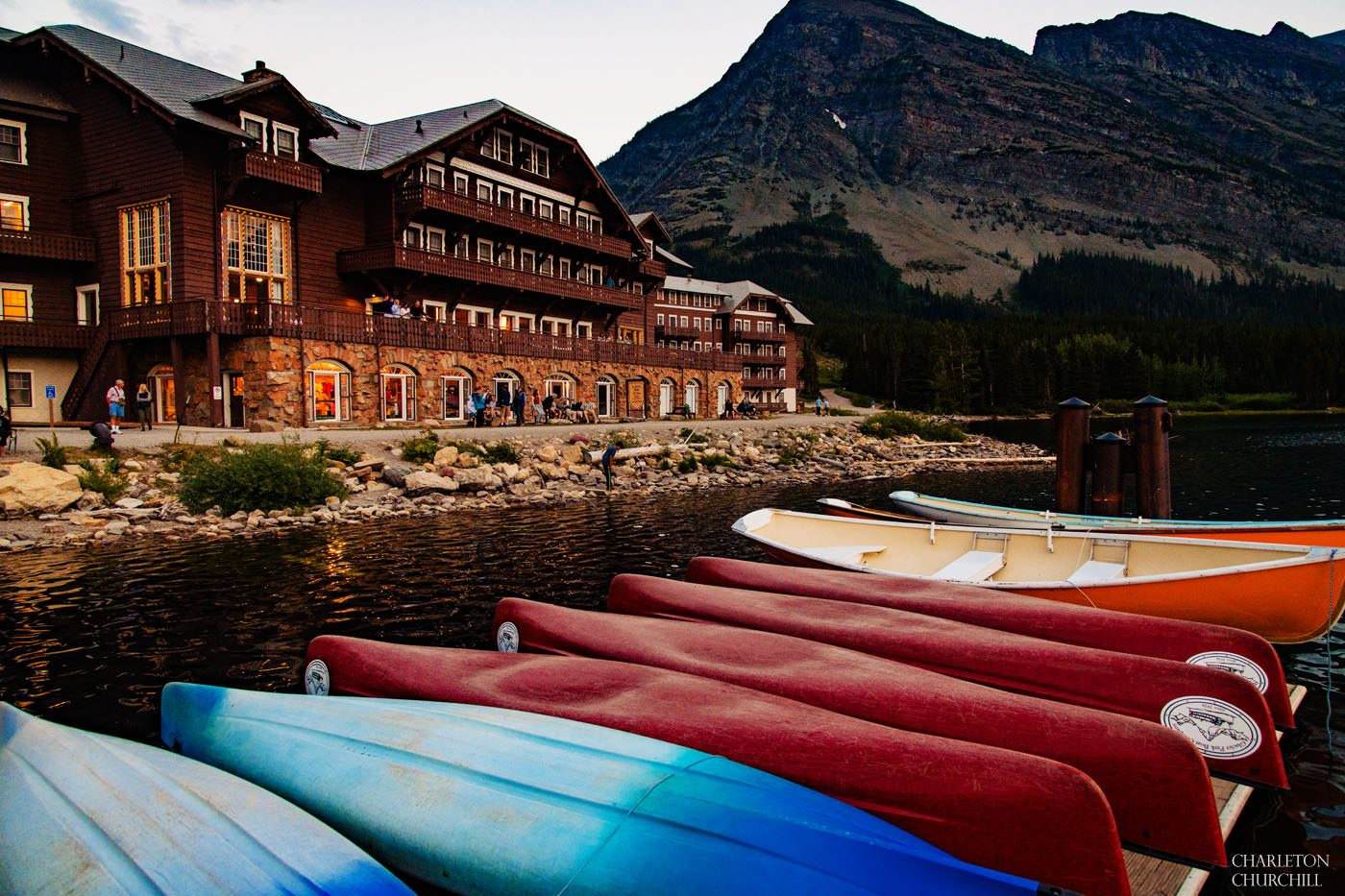 canoes and lake front of Many Glaciers Hotel lodging for wedding
