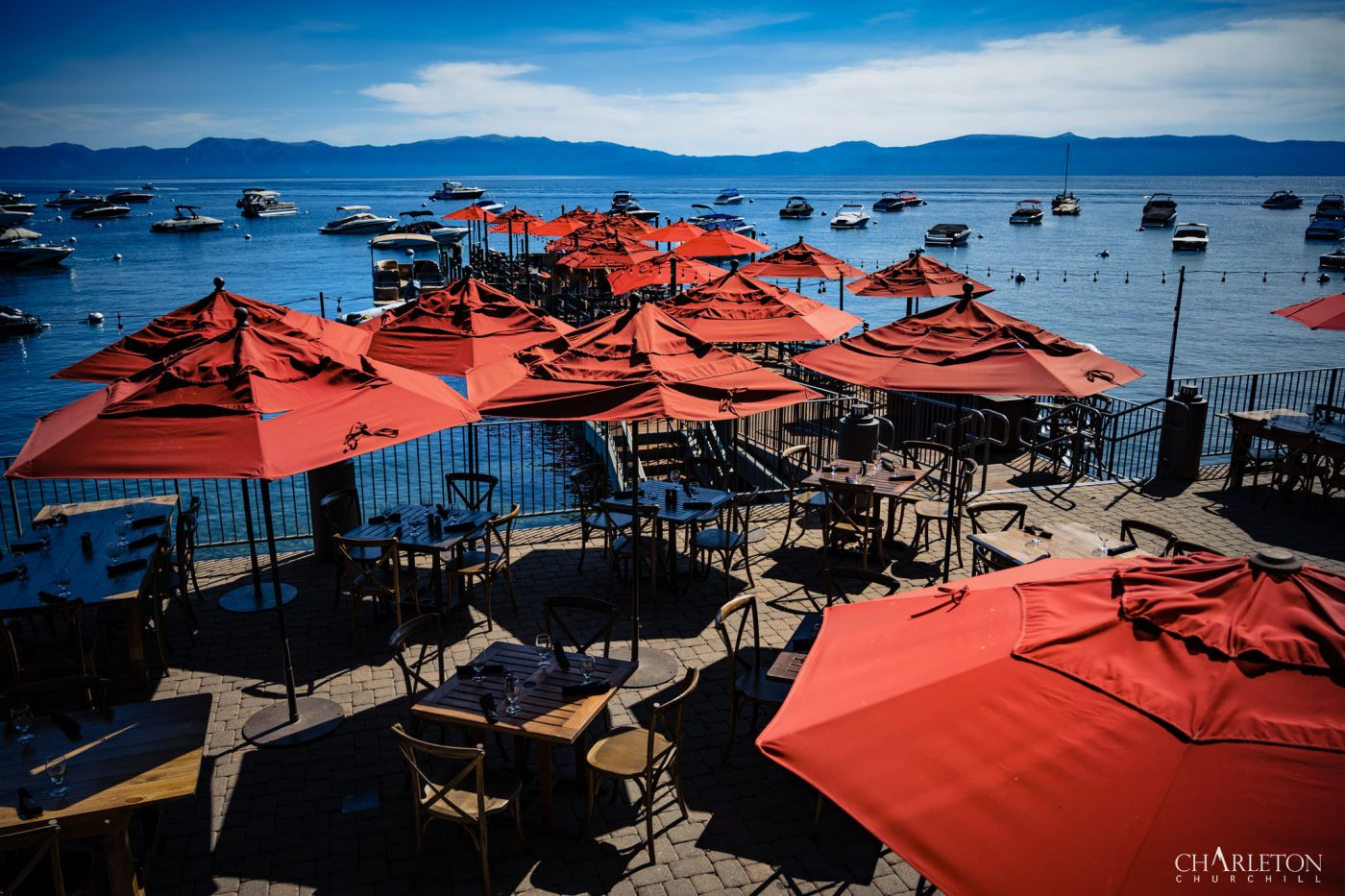 the dock of lake tahoe in West shore with red umbrellas for shade