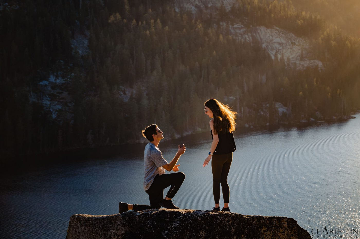 adventurous and romantic proposal, pulling out the ring on a mountain