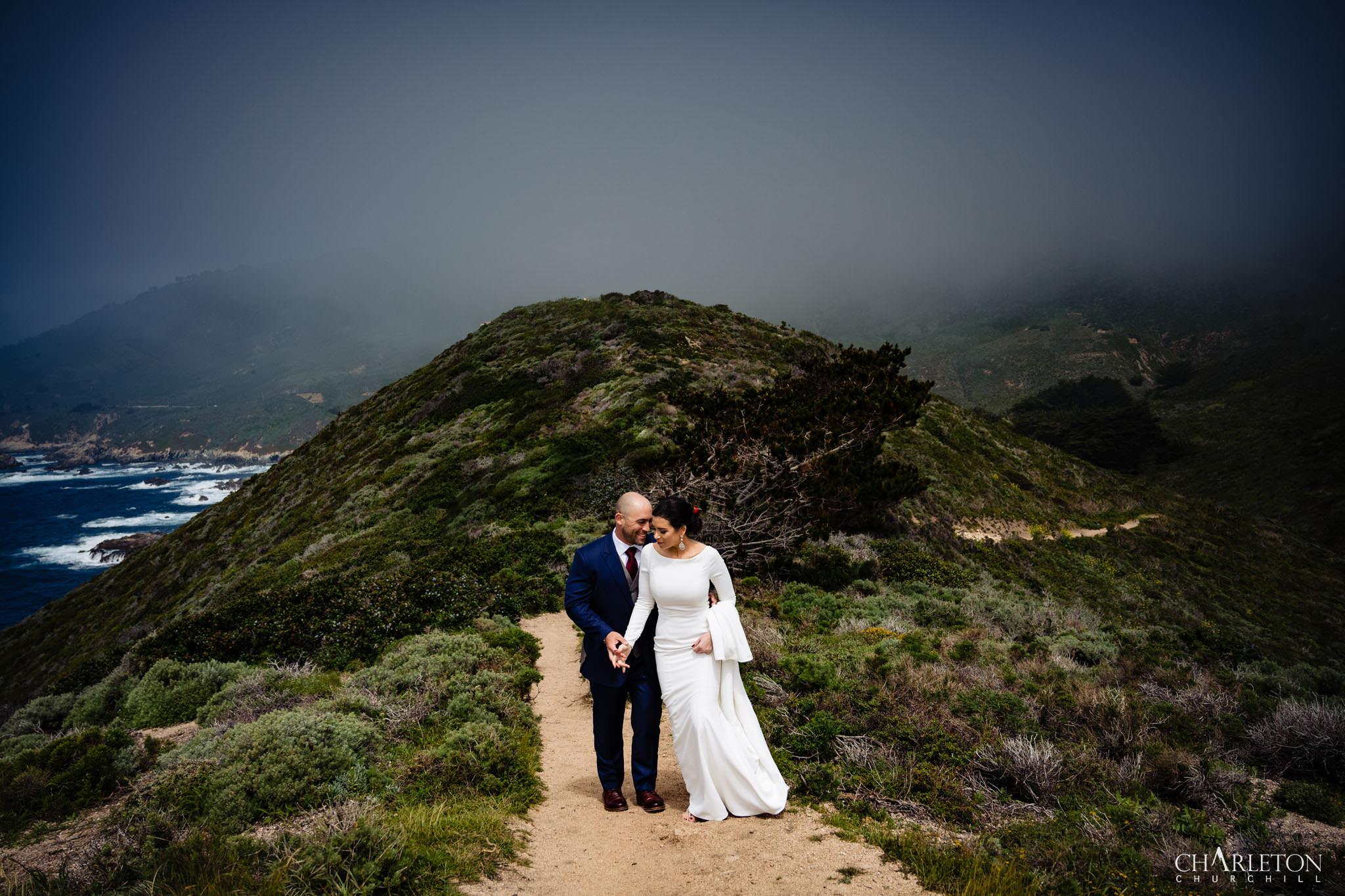 elopement couple romantic photos in big sur cliff area along the beach