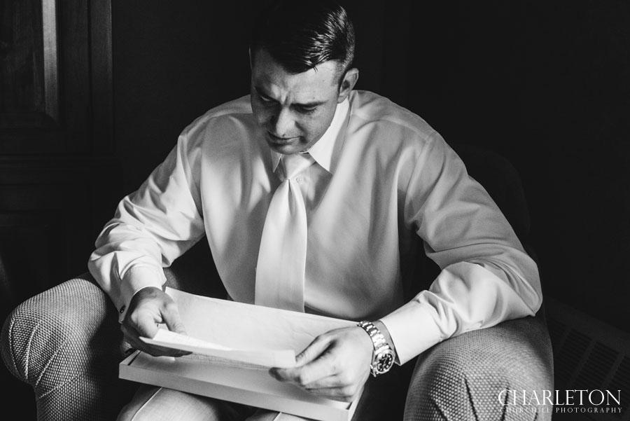 emotional groom reading bride's letter