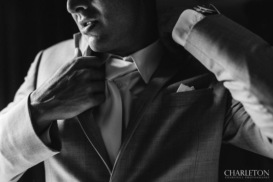 tahoe wedding groom puting on suit