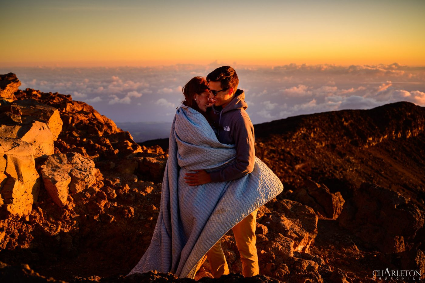 hawaii adventure wedding photographer capturing couple above the clouds on the mountain of Haleakala national park