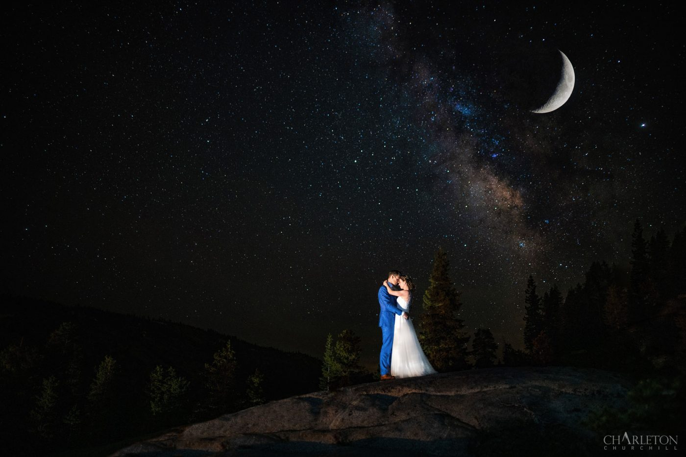 wedding couple under the milky way, stars and crescent moon