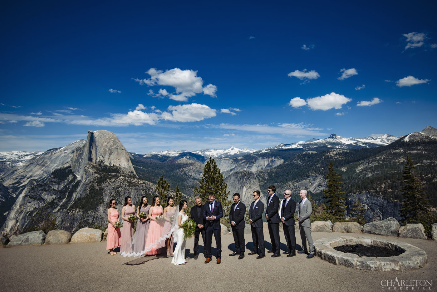 wedding ceremony at the amphitheater at glacier point yosemite venue with half-dome in the background
