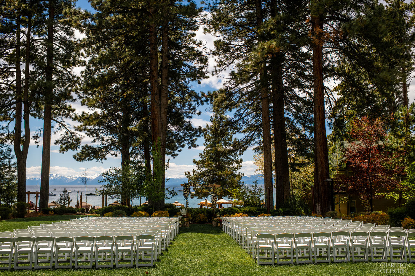 hyatt regency tahoe wedding on the lawn with the blue lake and mountains in the background