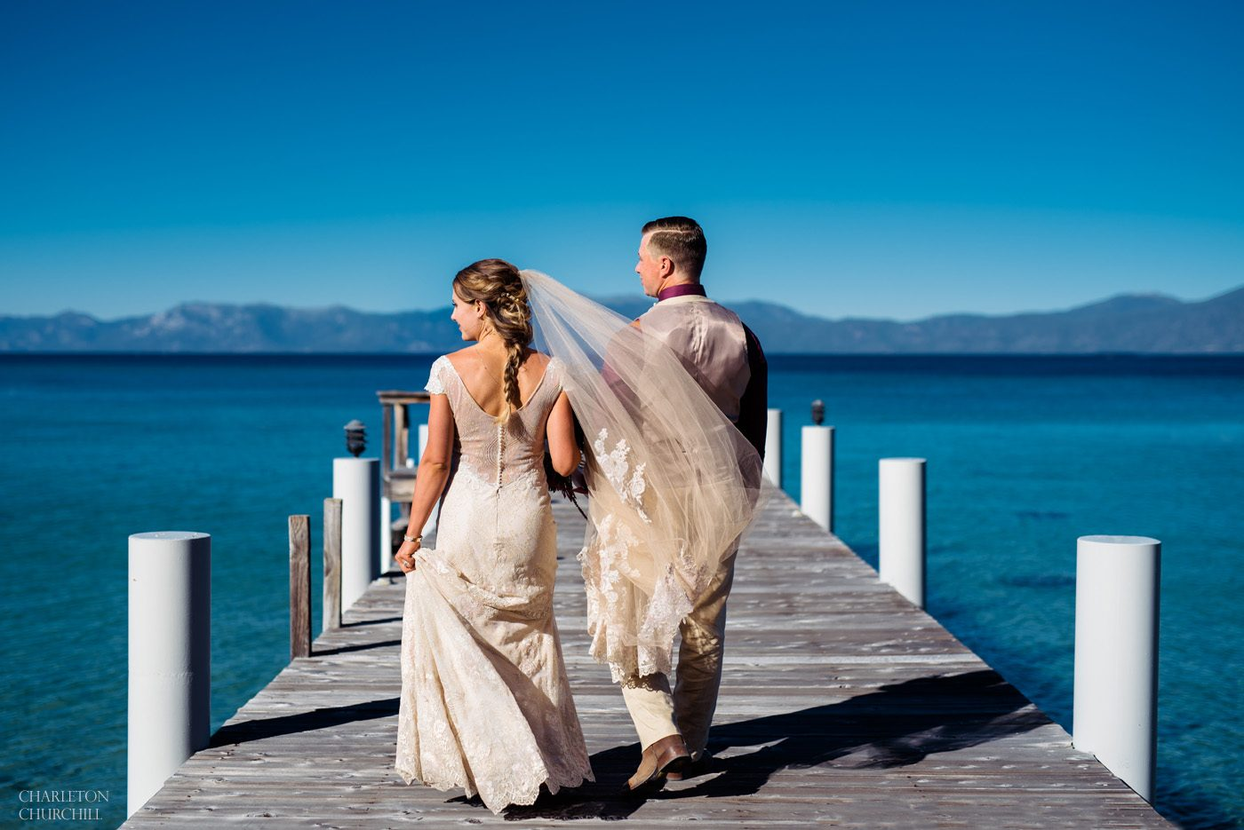 top lake tahoe wedding venues image of couple on dock of lake holding hands