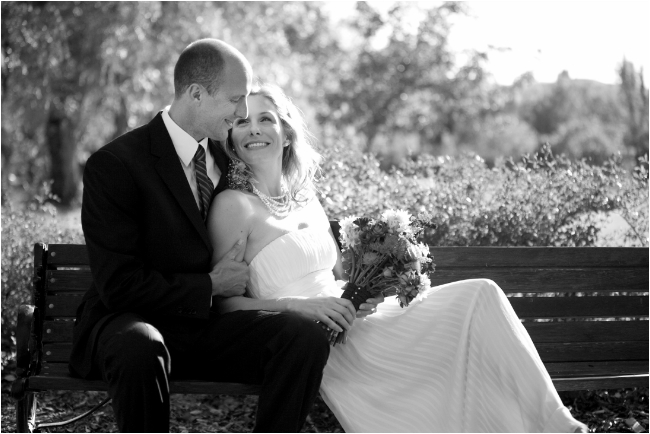 livermore wedding photographer shooting bride and groom on a bench at ravenwoods historic venue