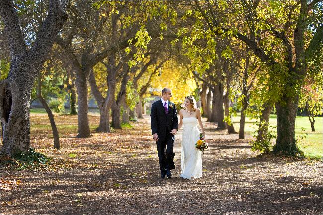 ravenwood historic site wedding photographer shooting between the trees in livermore