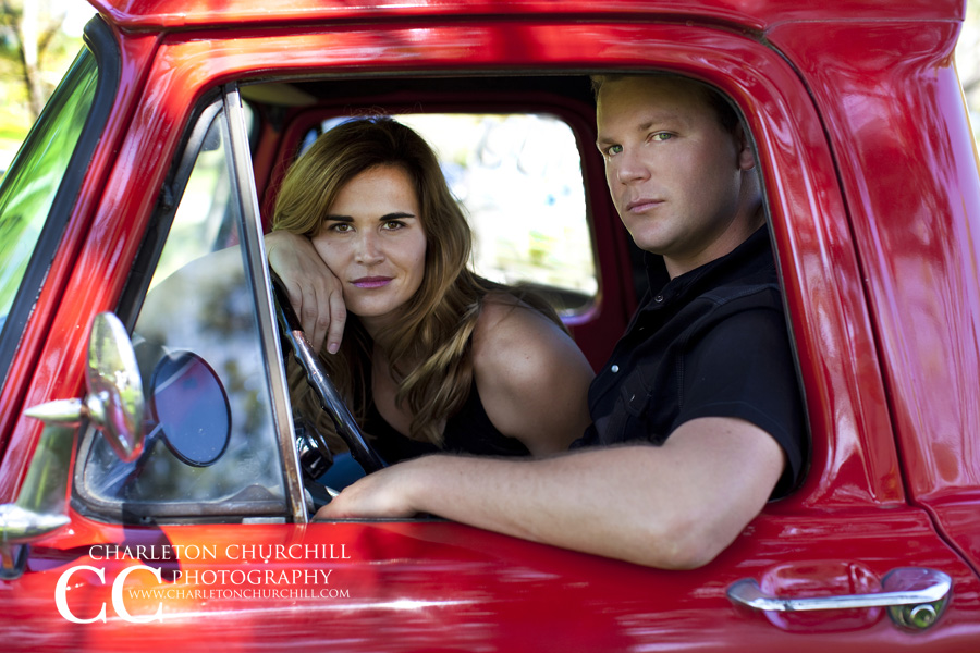 engaged couple in old truck