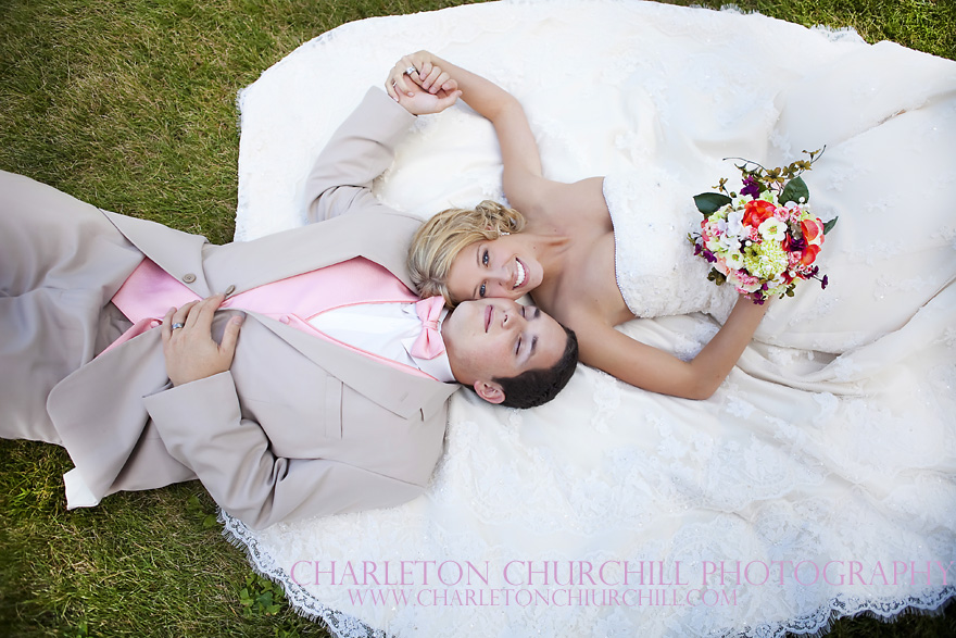bride groom laying in grass