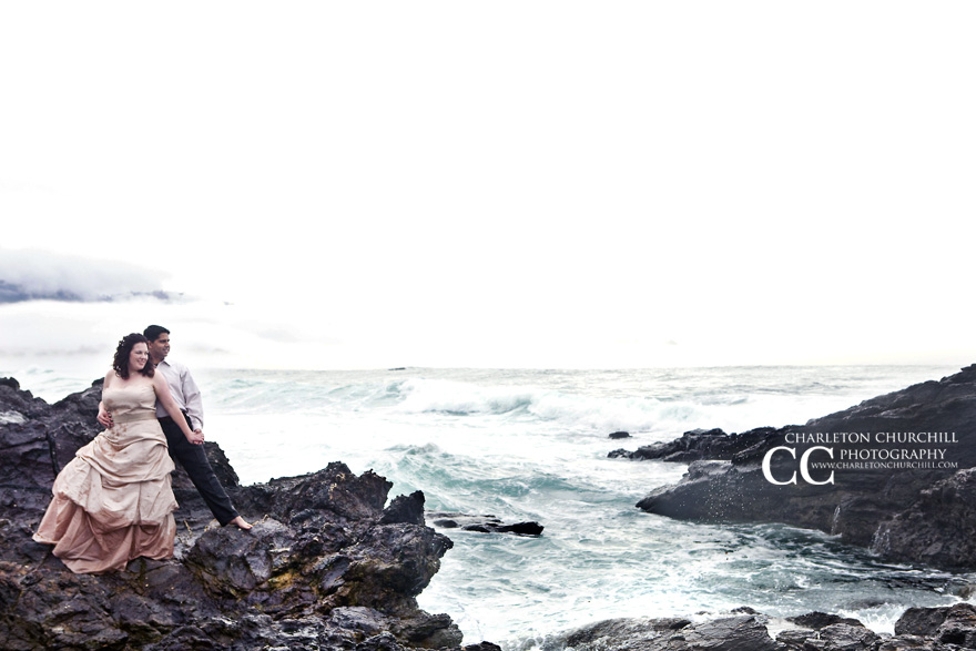 carmel beach wedding photography on the rocks and stormy waters posing for a picture