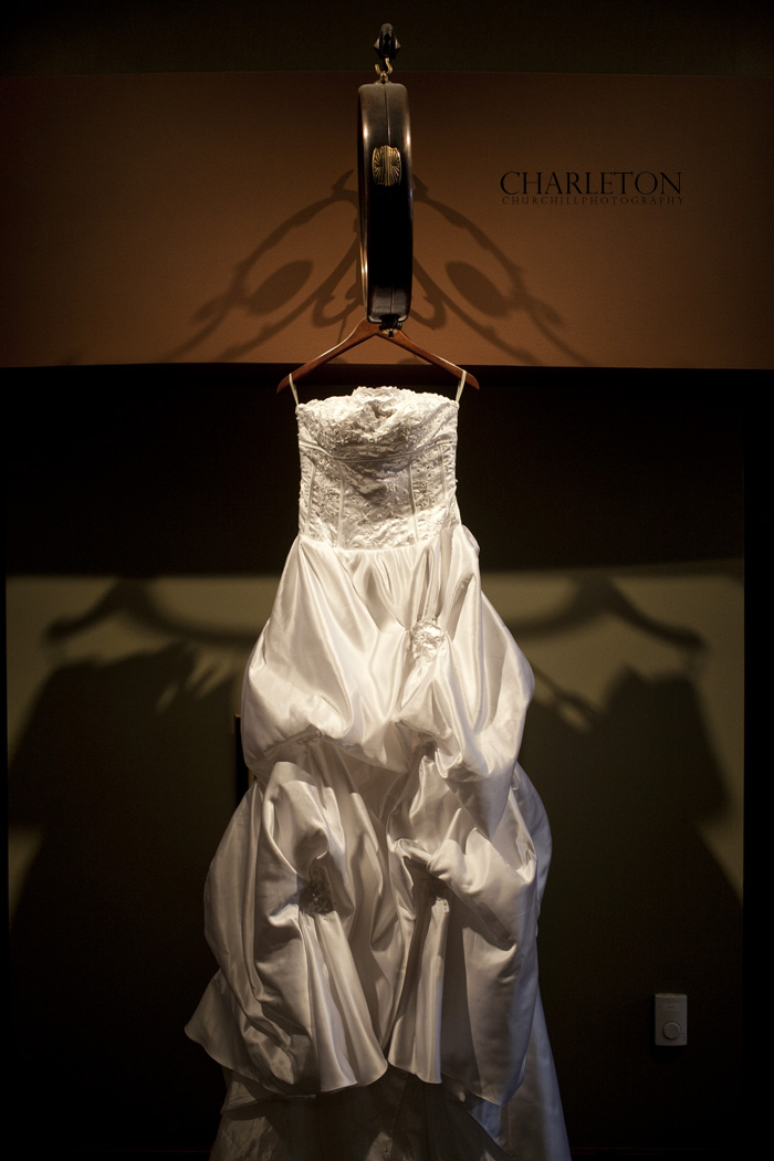 Wedding Dress hanging at the Fossil Trace Golf Course near the reception room