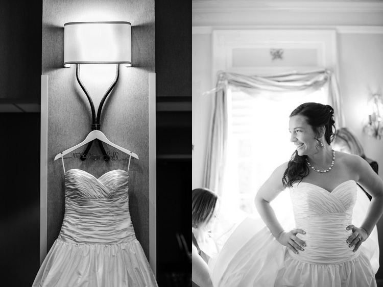 bride getting ready in hotel suite with dress