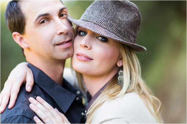 fashionable engagement session with hat down a country backroad