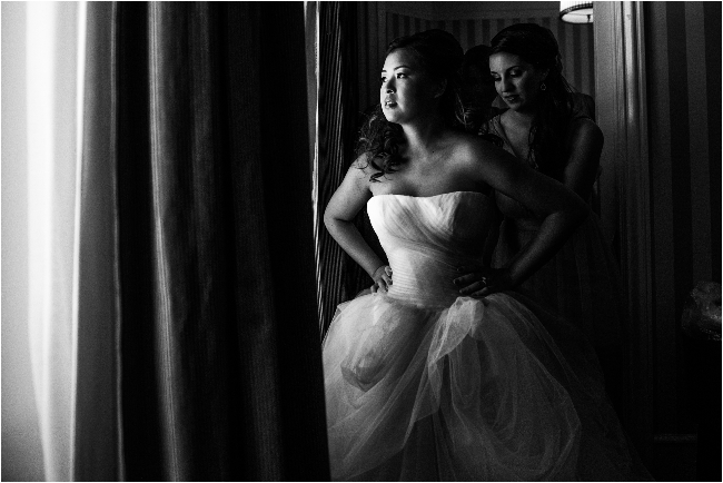 bride getting dress strapped on at Sacramento Citizen Hotel
