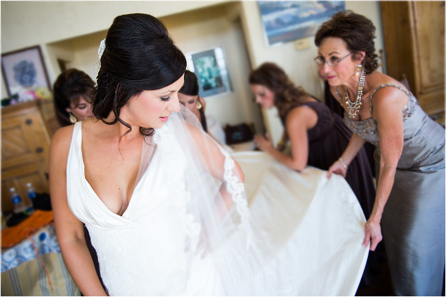 putting on of the dress at murphys wedding venue