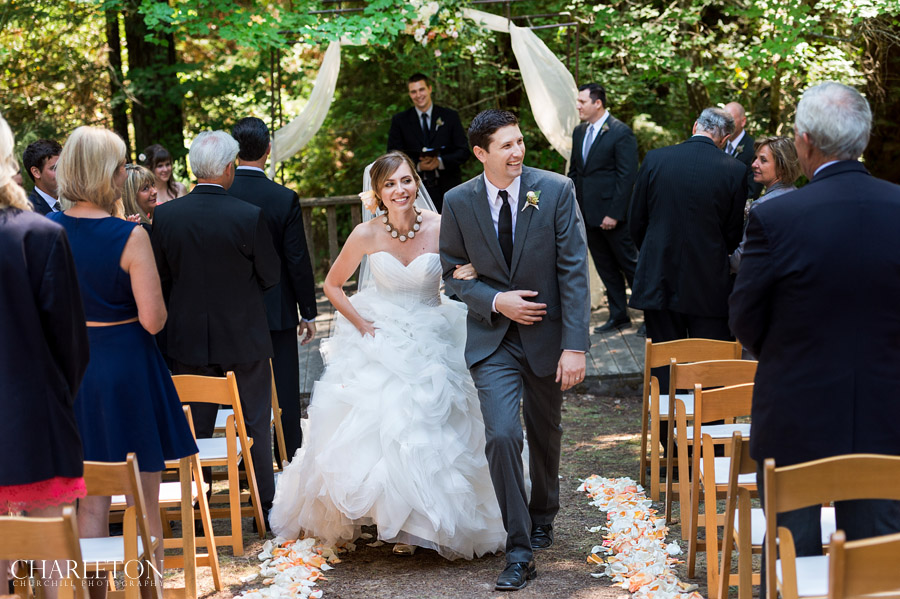 bride and groom walk down aisle after kissing of ceremony at griffith santa rosa