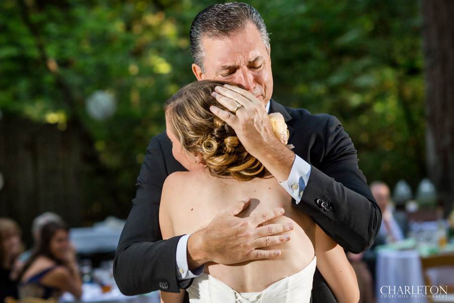 father crying with daughter on dance floor at griffith woods