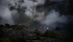 foggy mountains of yosemite with couple hiking after the rain