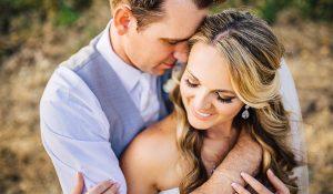 rancho victoria vineyard wedding couple holding each other romantically