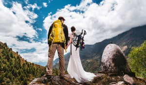 wedding couple just married standing on mountain near Everest in himalayas