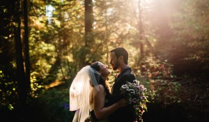 forest wedding couple in the woods kissing