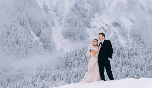 winter wedding snowing in mountains
