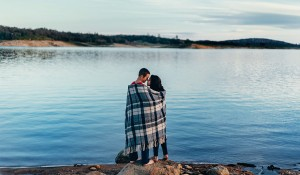 engagement shoot with blanket at the lake