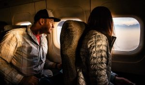 traveling on a plane to the Himalayas for a wedding this couple marries at base camp