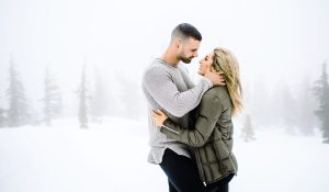 snowy winter engagement photo session with couple in a white out in north lake tahoe incline village