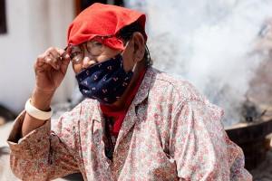lady burns incense around stupa