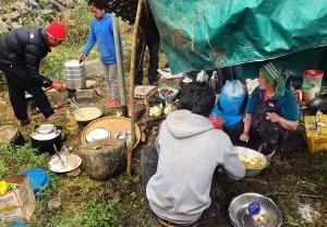 sherpa family feeding us food