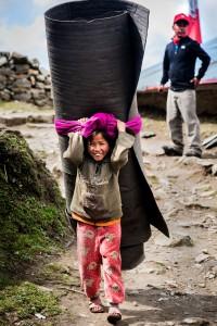 sherpa girl carrying load
