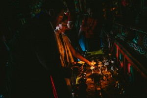 candles being lit by couple