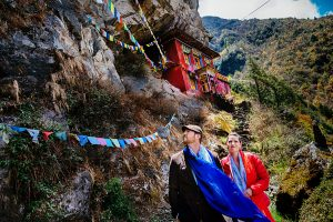 wedding couple offering prayer flags