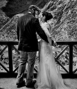 bride and groom looking out of monastery