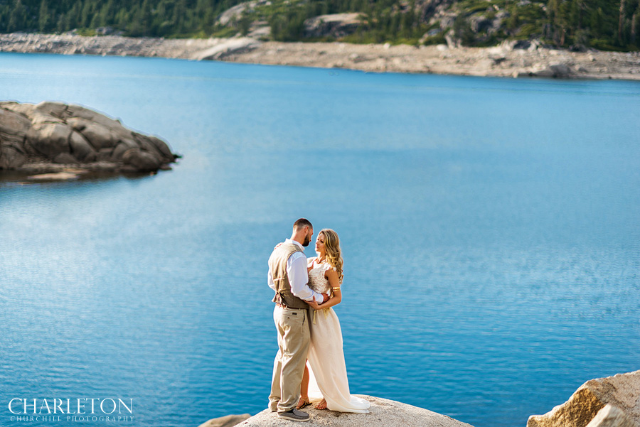 lake tahoe engagement photos over blue lake