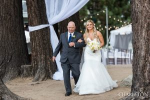 father walking bride down beach in south lake tahoe wedding ceremony