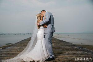 beach retreat and lodge wedding photos on dock with profoto lights